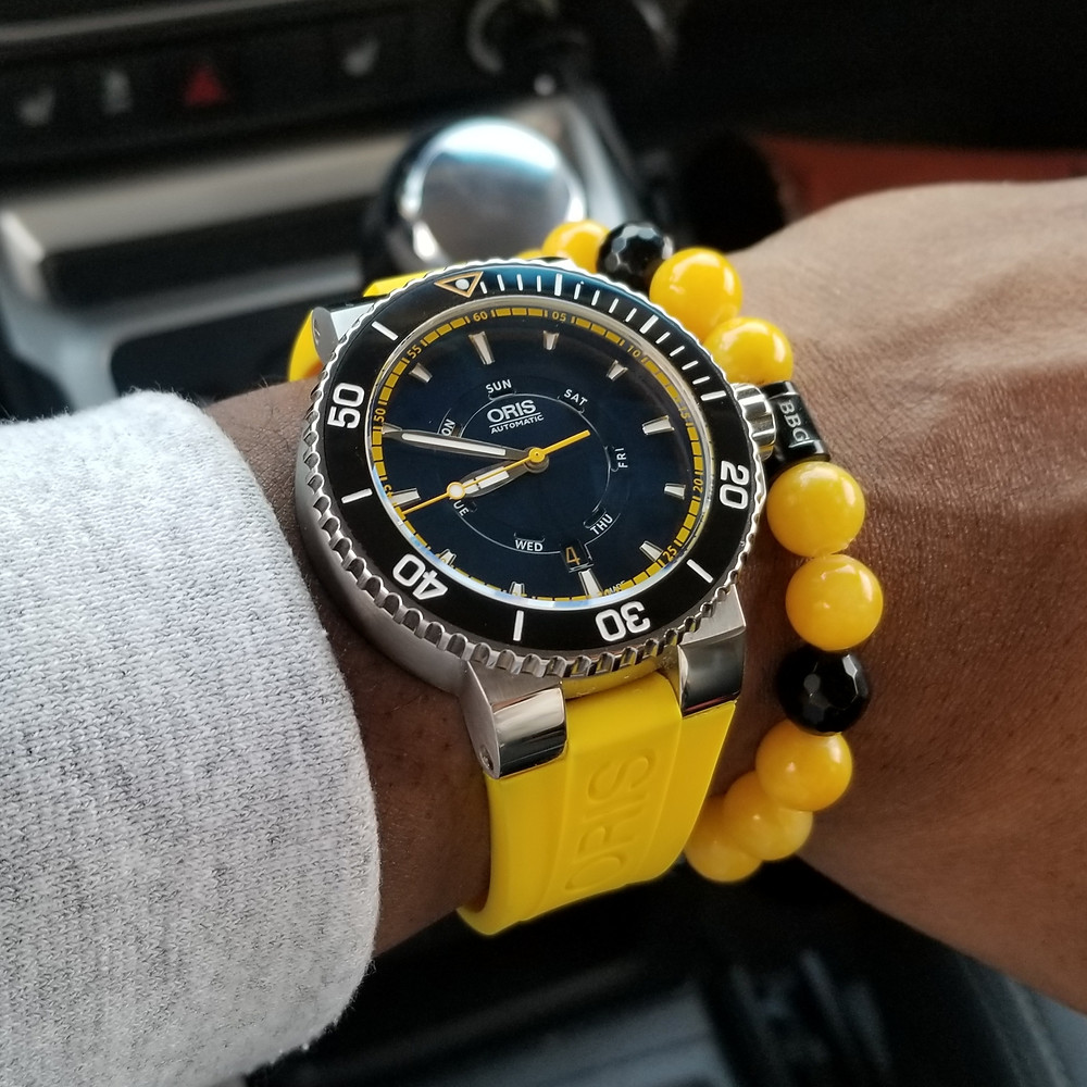 WOTD wrist-shot of the Oris, Aquis, Great Barrier Reef, Limited Edition II, paired with a custom designed, beaded bracelet, designed by Beads By Gonzo.