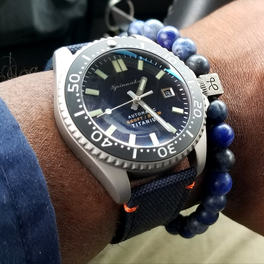 WOTD wrist-shot of the Spinnaker, Tesei, in Titanium.  Paired with a Sodalite stone, beaded bracelet, designed by Aurum Brothers.