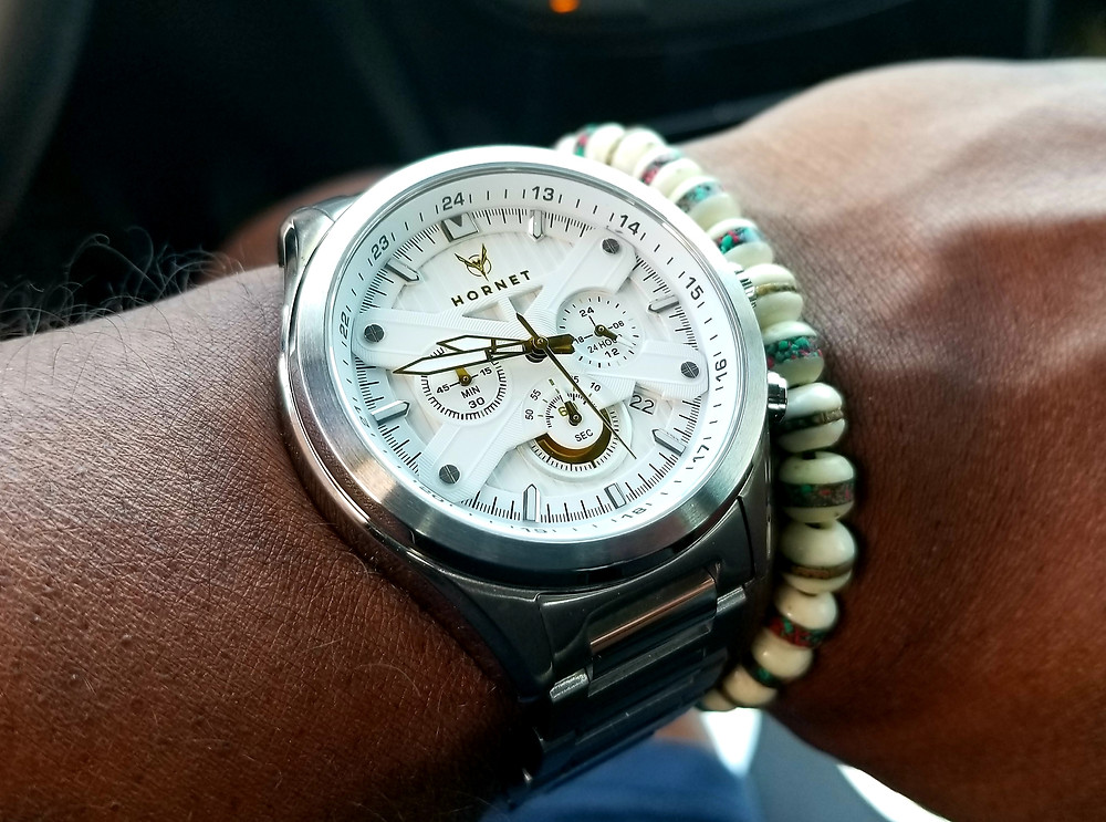 WOTD wrist shot of the Moto-Time, Hornet Chronograph, accessorized with a white Yak Bone beaded bracelet.
