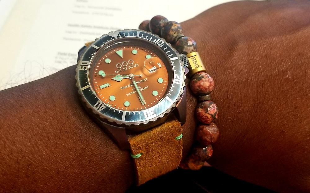 WOTD wrist shot of the Out Of Order, Casanova, accompanied by custom Beads By Gonzo beaded bracelet.