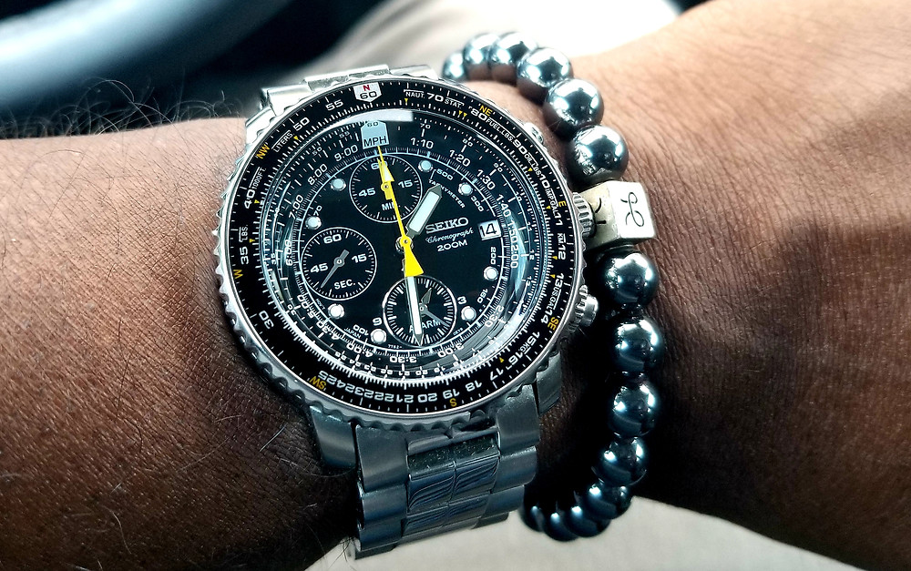 WOTD wrist-shot of the Seiko, Flight Alarm Chronograph, a/k/a Flightmaster, accessorized with a hematite, beaded bracelet, from vendor Aurum Brothers.