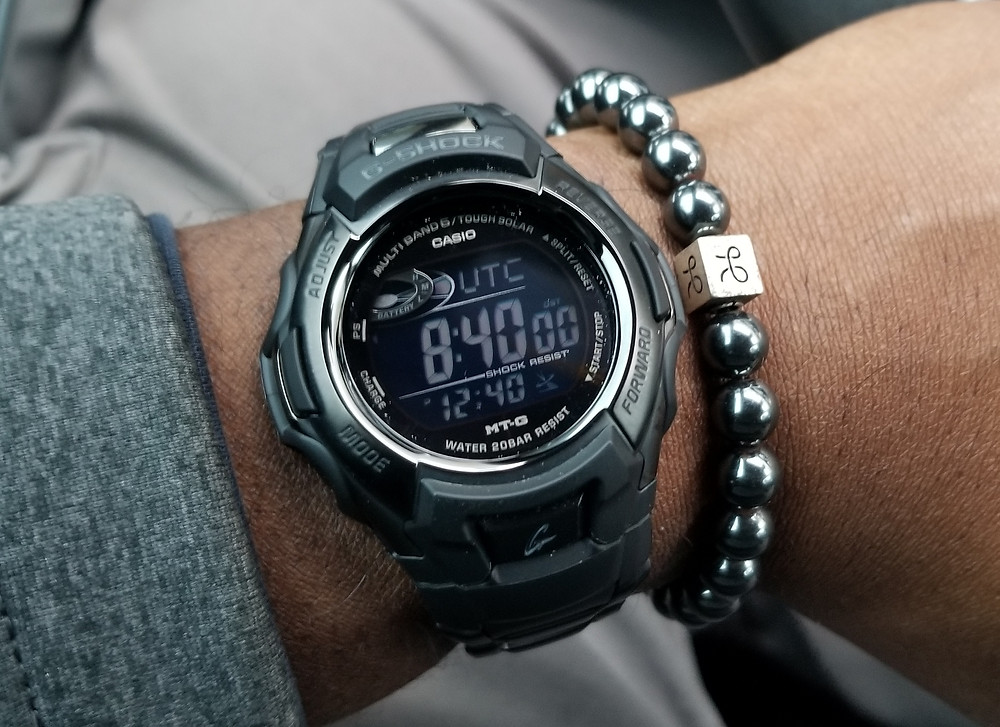 WOTD wrist shot of the Casio, G-Shock, Atomic, Tough Solar, paired with minimalist, Hematite, beaded bracelet from Aurum Brothers.