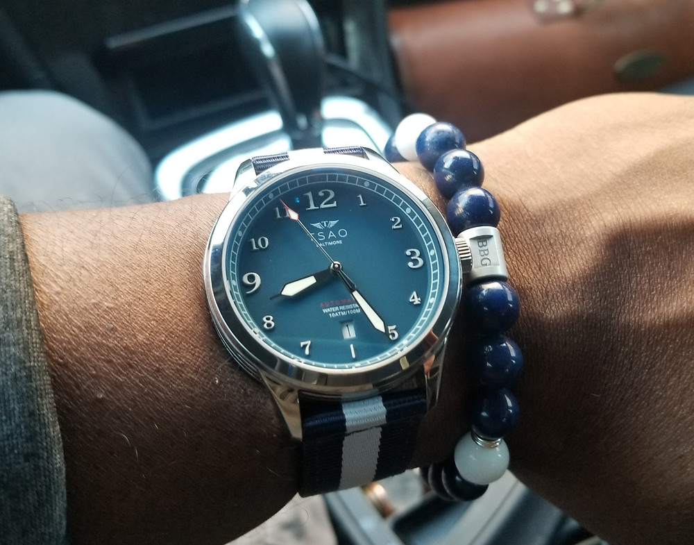 WOTD wrist-shot of the TSAO Baltimore, Limited Edition, paired with a custom beaded bracelet, designed by Beads By Gonzo.