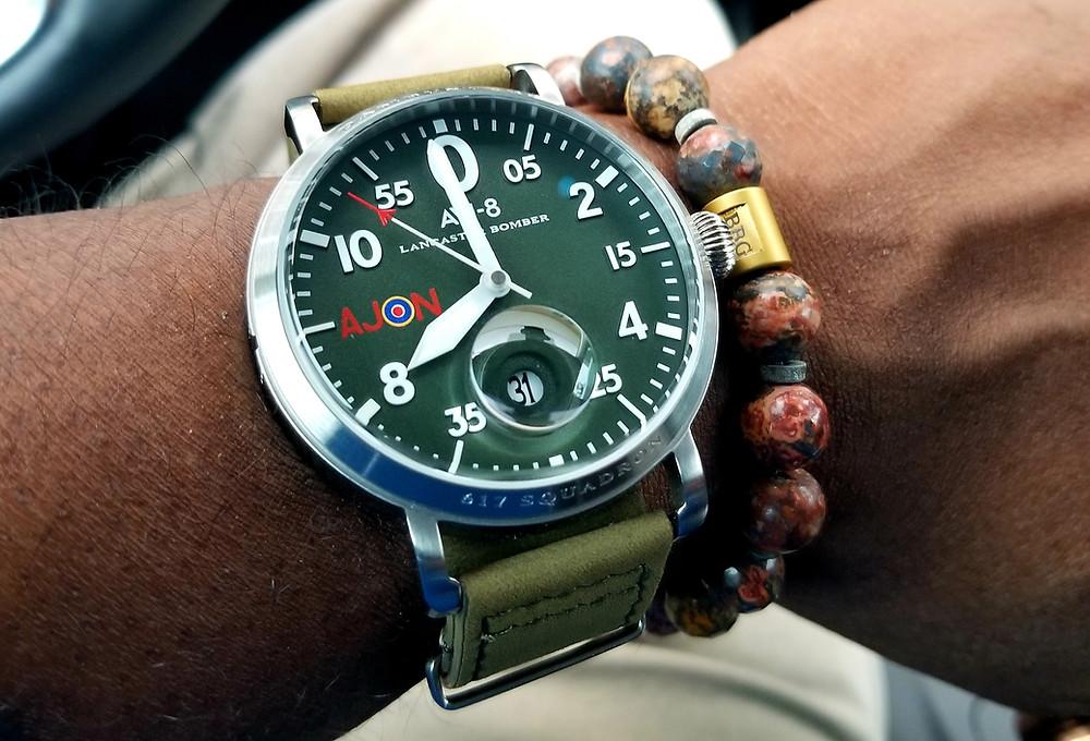 WOTD Wrist-Shot showing the AVI-8, Lancaster Bomber, Dambuster Pilot, accompanied by Beads by Gonzo custom beaded bracelet.