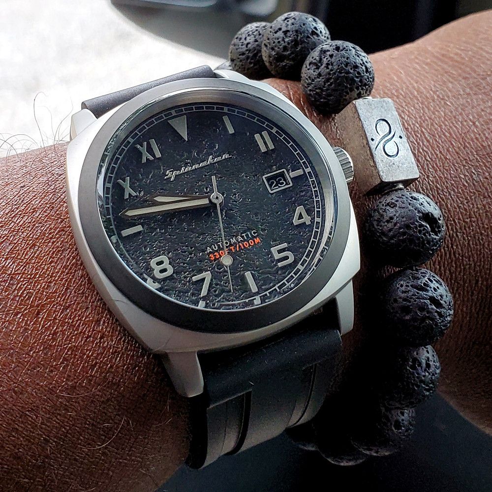 WOTD wrist-shot of the Spinnaker, Hull - California, Tactical Edition.  Paired with a Premium, lava stone bracelet, designed by Aurum Brothers.