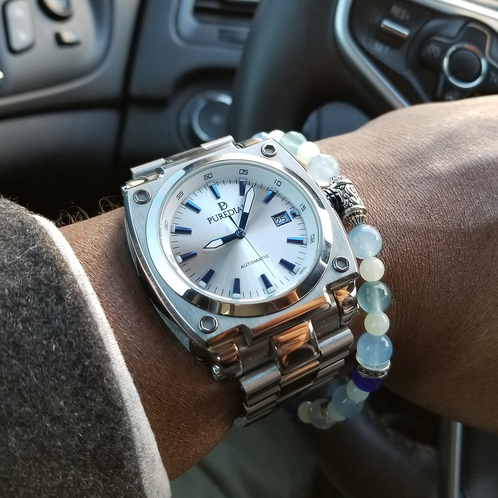 WOTD wrist-shot of the PureDial, Powersphere Automatic, paired with a custom, beaded bracelet.