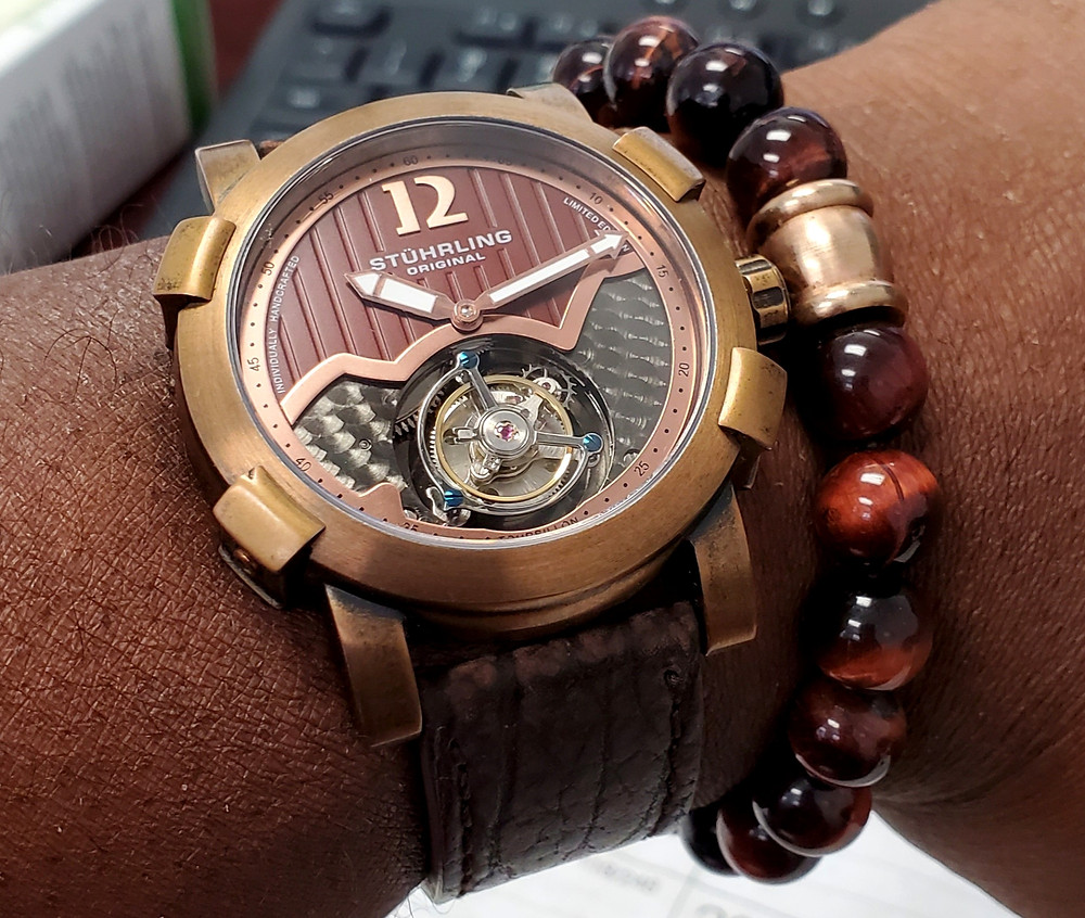 WOTD wrist-shot of the Stuhrling Original, Devilray Tourbillon - Bronze.  Paired with a Tiger's-Eye, beaded bracelet.