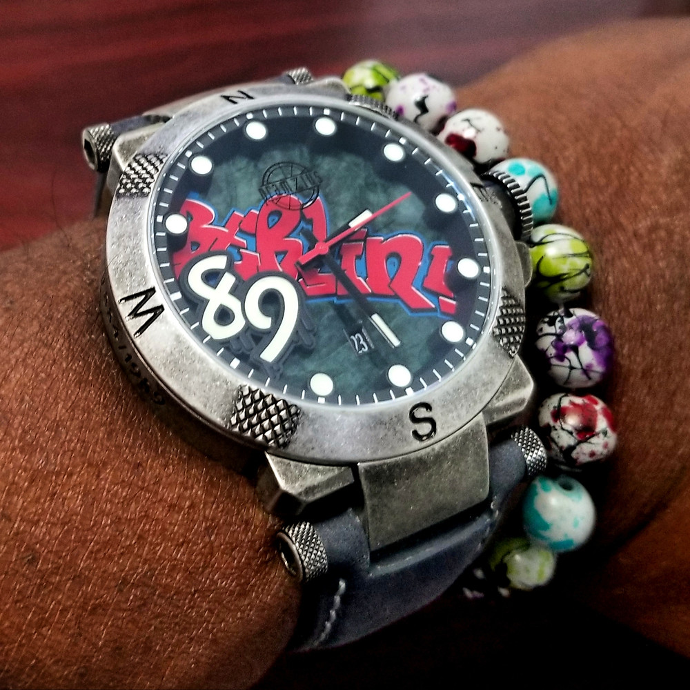 WOTD wrist-shot of the Pramzius, Fall of the Berlin Wall, Limited Edition.  Paired today with graffiti print, beaded bracelet.