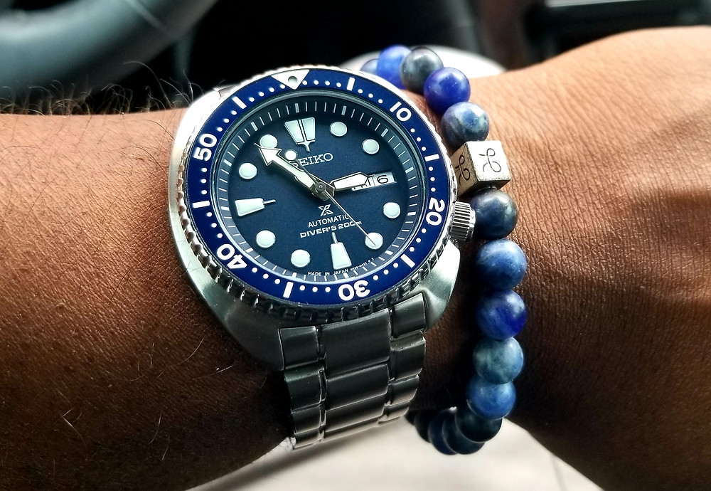 Wrist shot of Seiko Prospex Automatic Dive complimented watch with Arum Brothers minimal silver sodalite beaded bracelet.