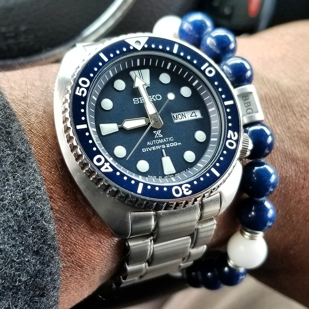 "WOTD wrist-shot of the Seiko Prospex ""Turtle"" Diver.  Paired with a custom, beaded bracelet, designed by Beads By Gonzo."
