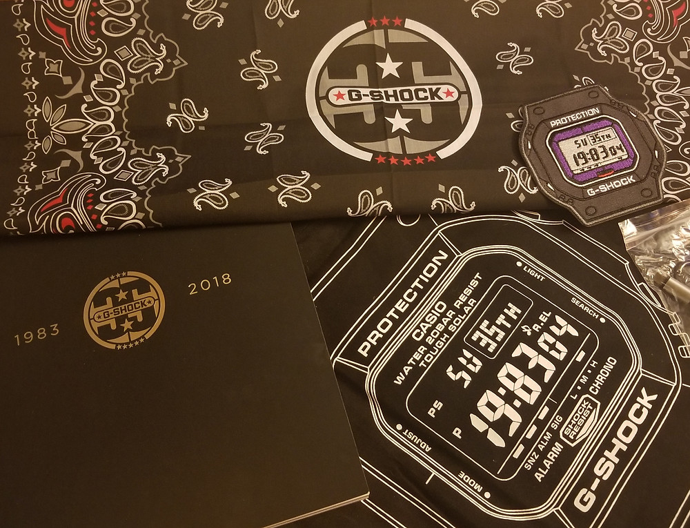 G-Shock carry bag, bandanna, patch, key-chain, and catalog history book.