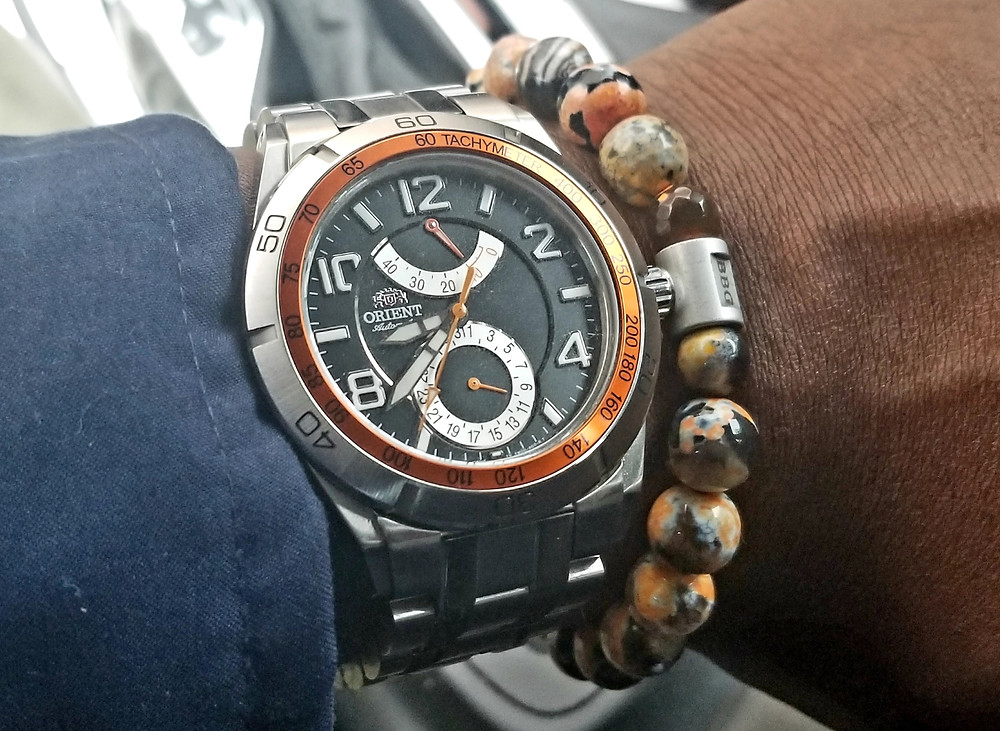 WOTD wrist shot of the Orient, Planet-Orient, Power-Reserve, paired with a custom beaded bracelet from Beads By Gonzo.