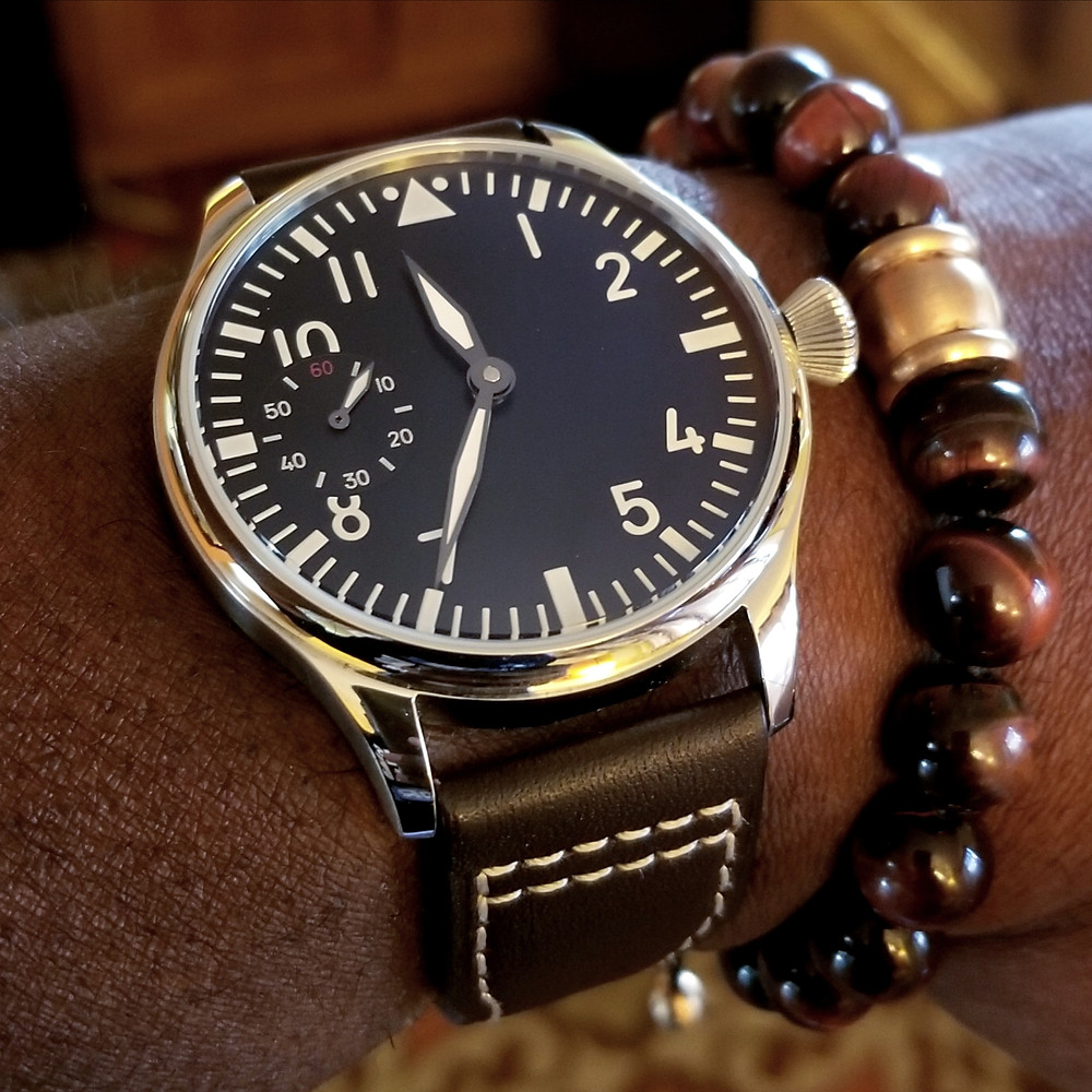WOTD wrist-shot of the Parnis, Big Pilot - Mechanical, Sterile Dial.  Complemented by large-gauge, Tiger's-Eye stone bracelet.