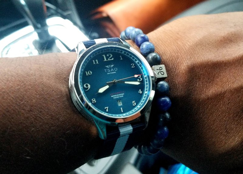 WOTD wrist shot of the TSAO Baltimore, Founder's, Limited Edition, accessorized with an Aurum Brother's, minimalist, sodalite bracelet.