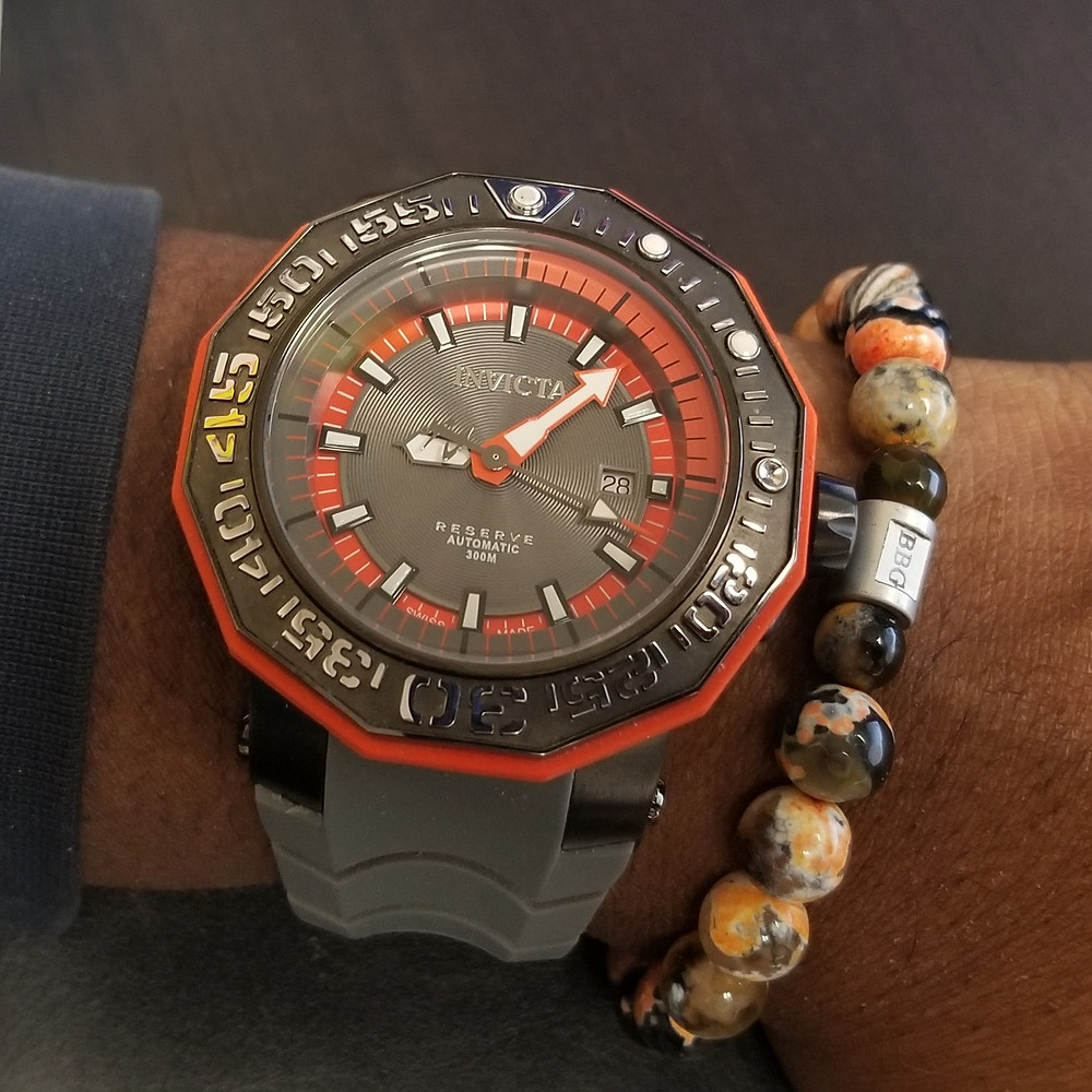 WOTD wrist-shot of the Invicta Reserve, Orange Sea Monster, paired with custom, beaded bracelet, designed by Beads By Gonzo.