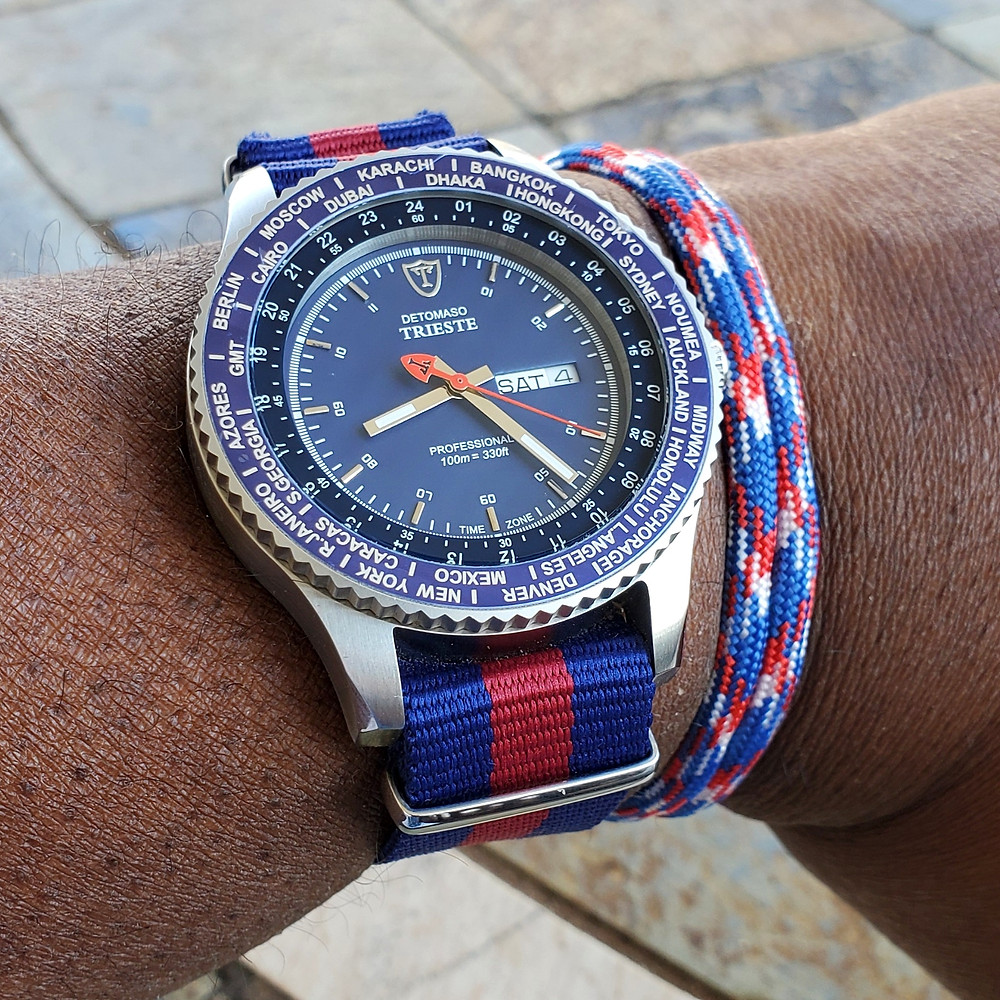 WOTD wrist-shot of the Detomaso, Trieste - Globetrotter, paired with a Chasing Fin, patriotic, rope bracelet.