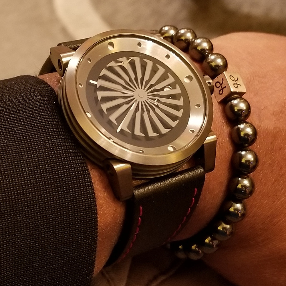 WOTD wrist-shot of the Zinvo Blade, in gunmetal, paired with a minimalist, hematite, beaded bracelet, by Aurum Brothers.