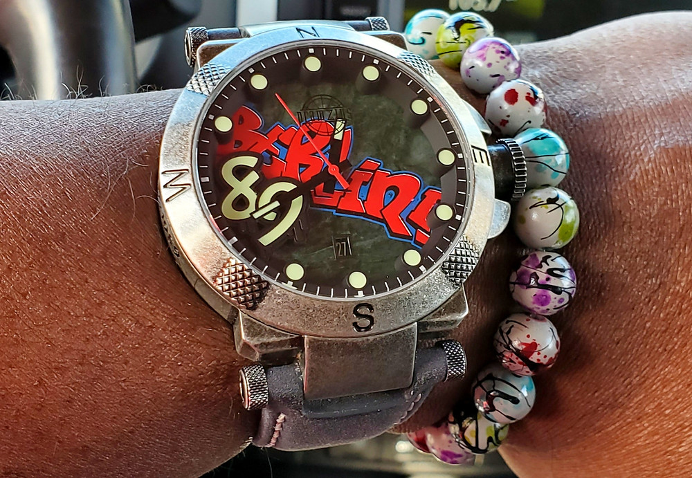 WOTD wrist-shot of the Pramzius, Berlin Wall Watch, Limited Edition.  Paired with custom, graffiti-splash, beaded bracelet.