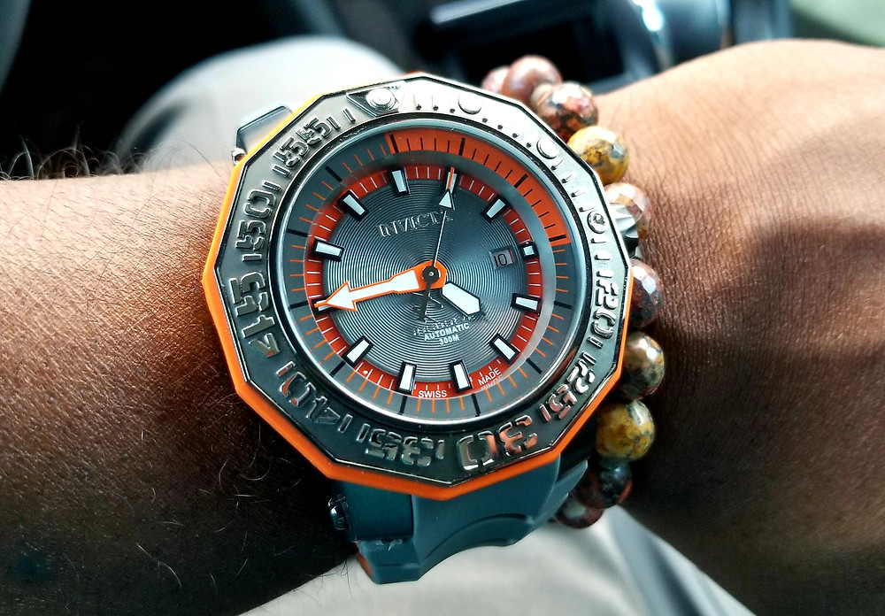 WOTD Wrist Shot of an Invicta, Orange Sea Monster, paired with a custom-designed Beads by Gonzo Bracelet.