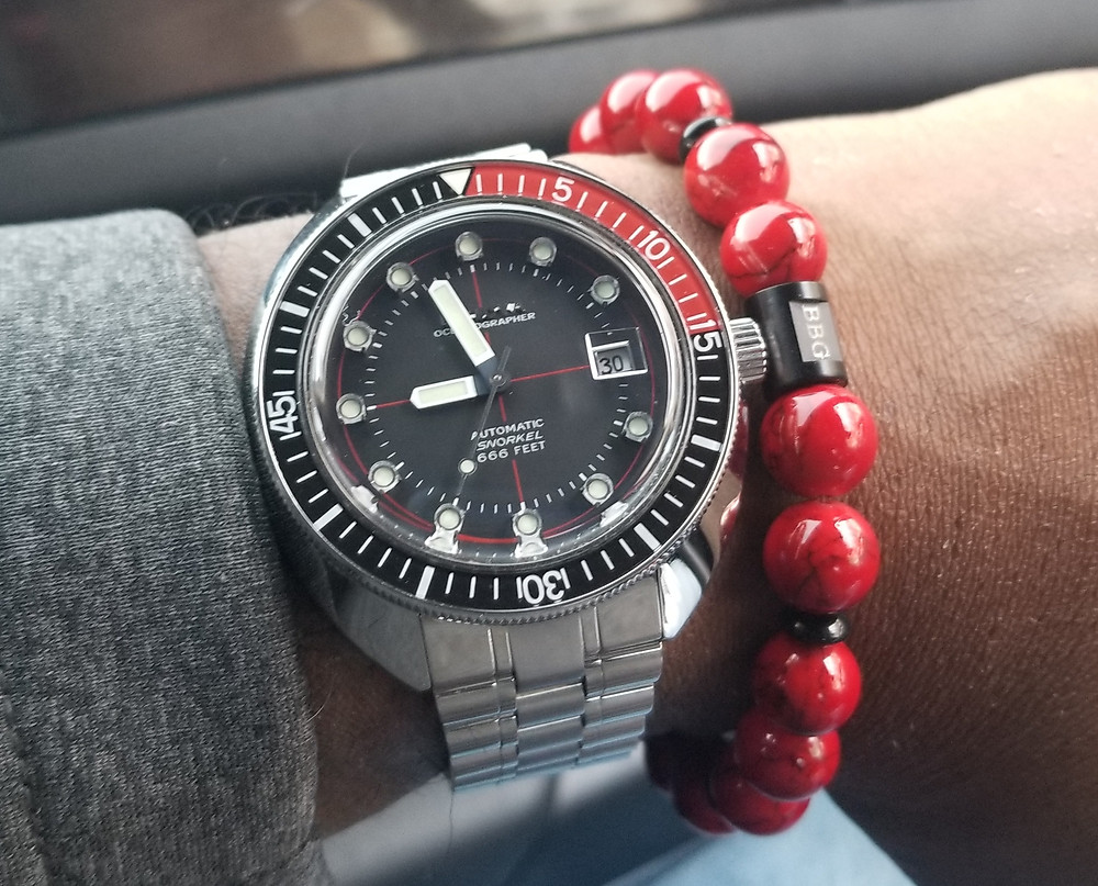 WOTD wrist-shot of the Bulova, Oceanographer, Devil Diver 666, Re-Issue, paired with a custom, color-coordinated, beaded bracelet, designed by Beads By Gonzo.