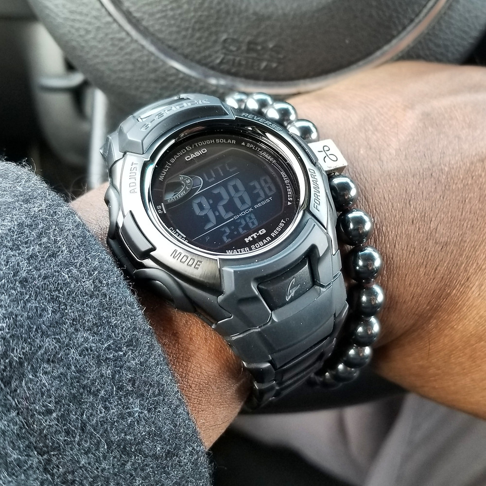 WOTD wrist-shot of the G-Shock, Tough Solar, paired with a minimalist, hematite, beaded bracelet, designed by Aurum Brothers.