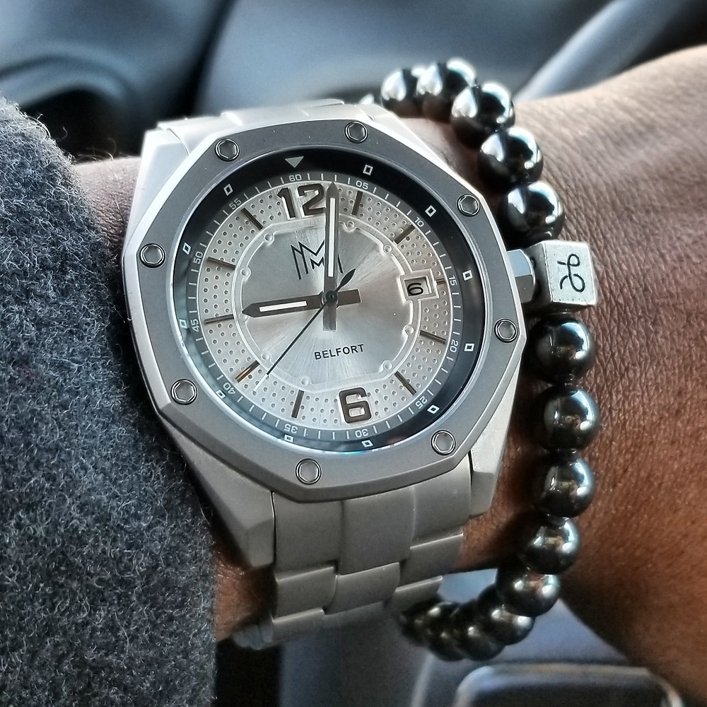 WOTD wrist-shot of the Belfort, Modern Made Man Automatic, in Titanium.  Paired with a minimalist, hematite, beaded bracelet, crafted by Aurum Brothers.
