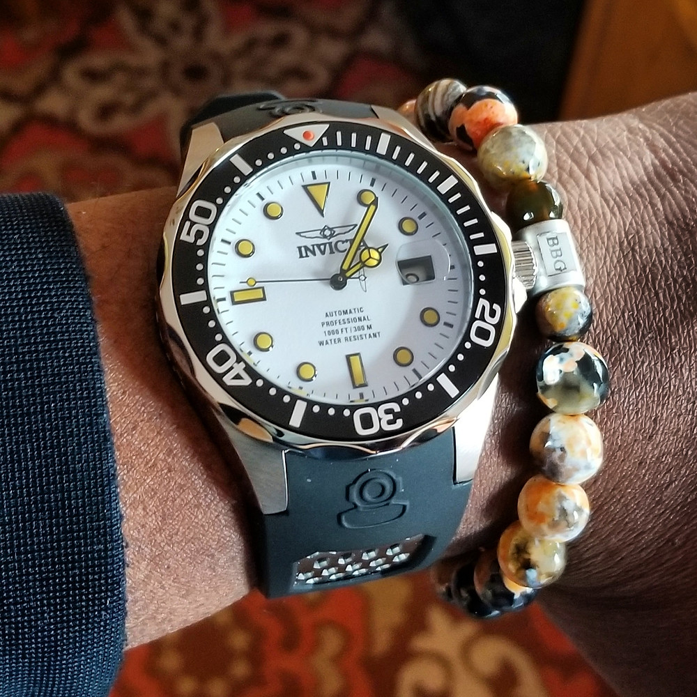 "WOTD wrist-shot of the Invicta ""Creamsicle"" Grand Diver.  Paired with a custom, beaded bracelet, designed by Beads By Gonzo."