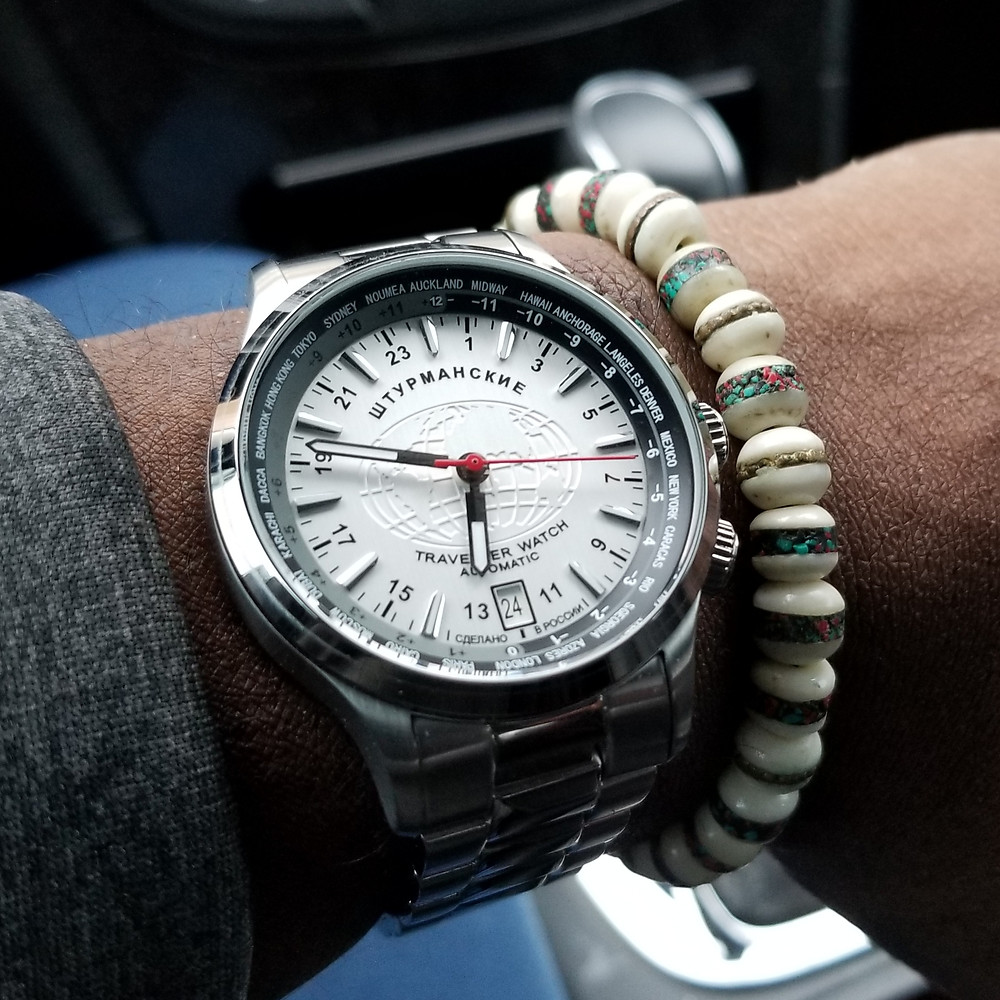 WOTD wrist-shot of the Sturmanskie, Automatic TravellerWatch, World-Timer,  paired with a Yak bone, copper-infused beaded bracelet.