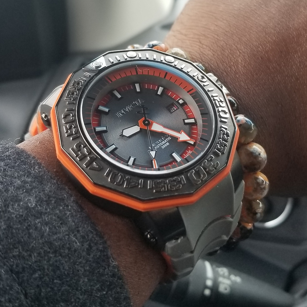 WOTD wrist-shot of the Invicta Reserve, Orange Sea Monster, paired with a custom-made, beaded bracelet, designed by Beads By Gonzo.