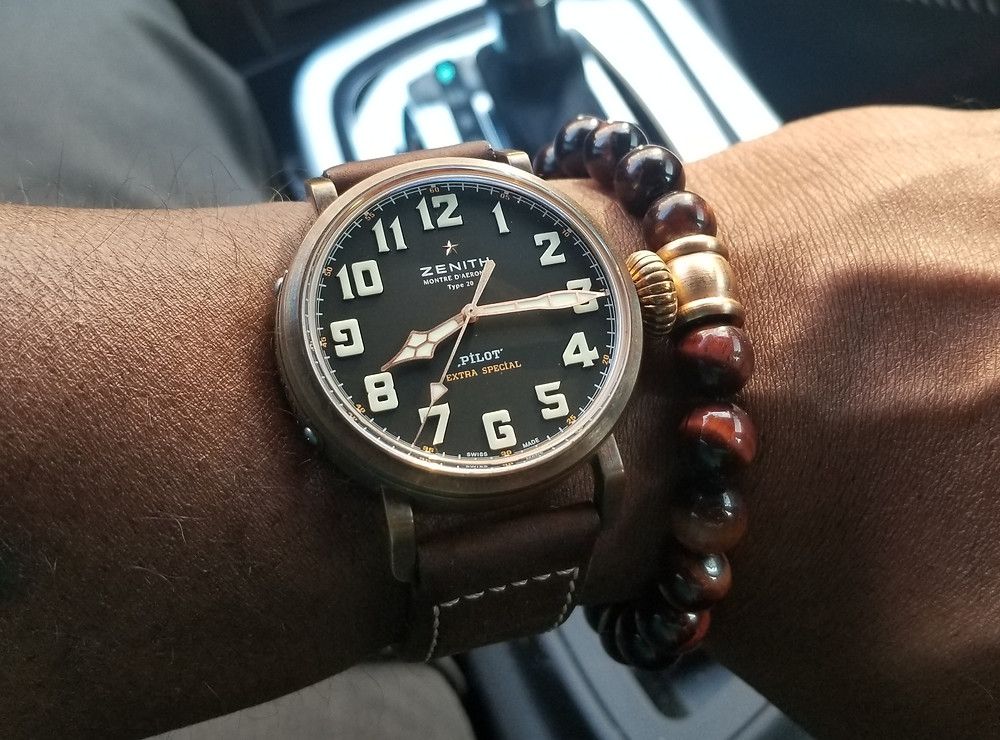 WOTD Wrist-Shot showing the Zenith, Montre D'Aeronef, Type 20, Extra Special, accompanied by a tiger's eye beaded bracelet.