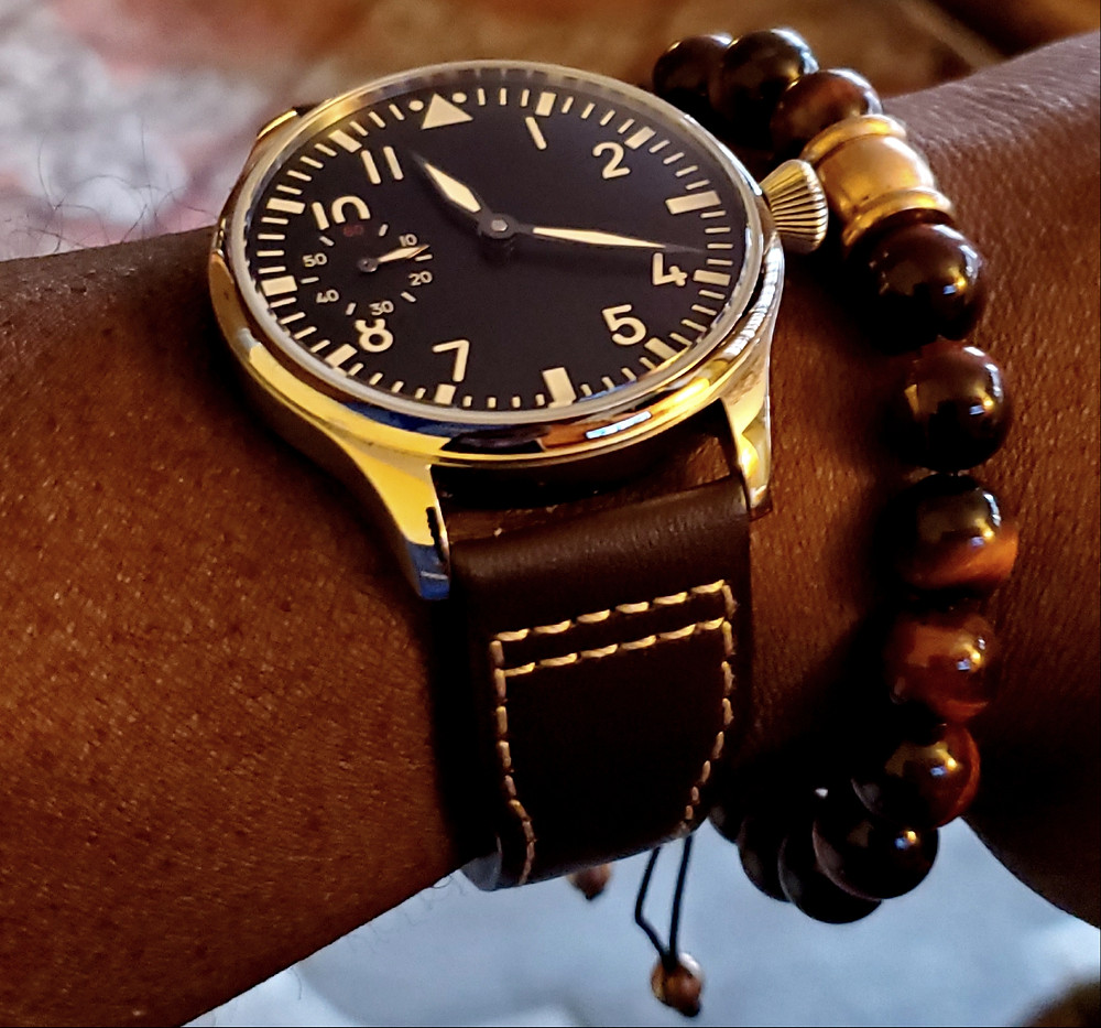 WOTD wrist-shot of the Parnis, Big Pilot Mechanical, With Sterile Dial.  Paired large-gauge, Tiger's Eye stone bracelet.