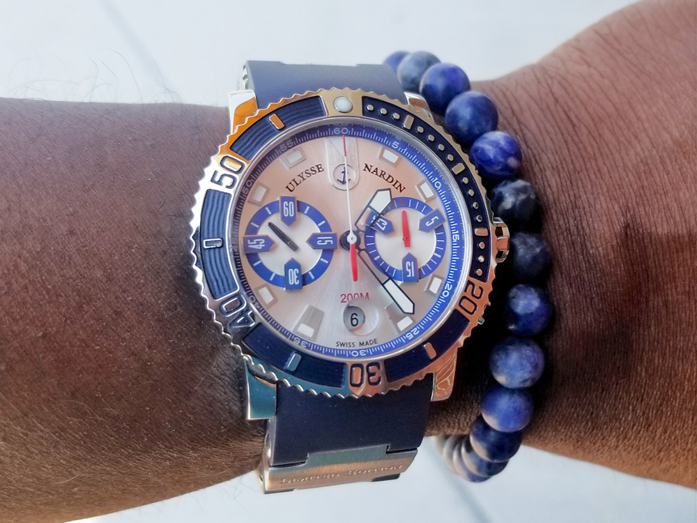 WOTD wrist shot of the Ulysse Nardin Maxi-Marine Diver in blue, accompanied by silver sodalite beaded bracelet.