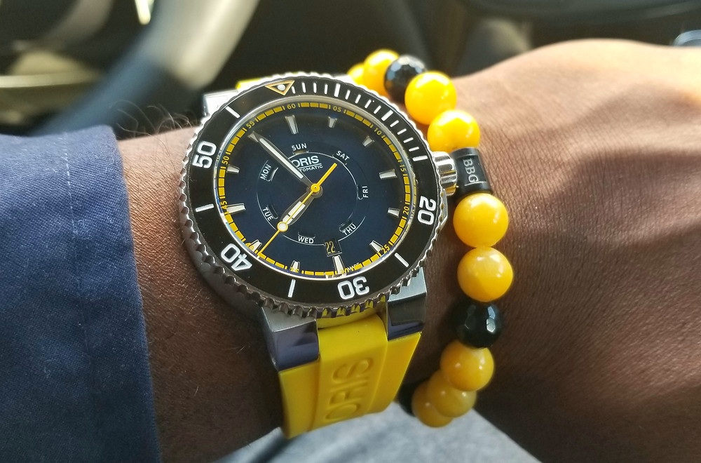 WOTD Wrist-Shot showing the Oris, Aquis, Great Barrier Reef Dive Watch, accompanied by Beads by Gonzo custom beaded bracelet.