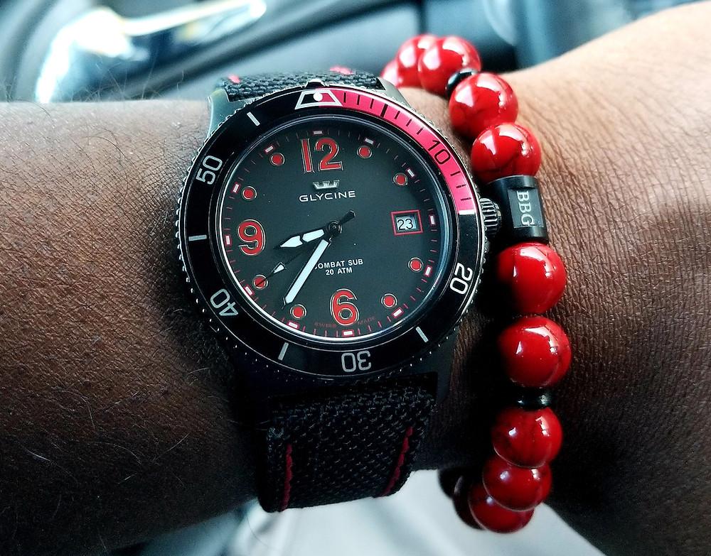 WOTD Wrist-Shot showing the Glycine, Combat Sub, accompanied by beaded bracelet, custom designed, by Beads By Gonzo.