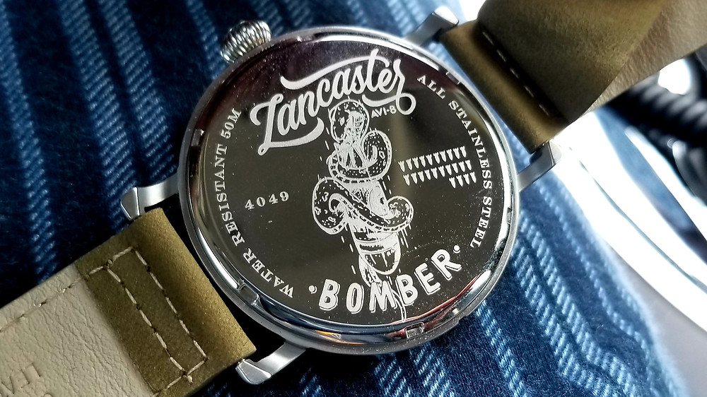 Laser-etched engraving of the Lancaster Bomber logo, on the rear caseback of the AVI-8, Lancaster Bomber, Damnbuster.