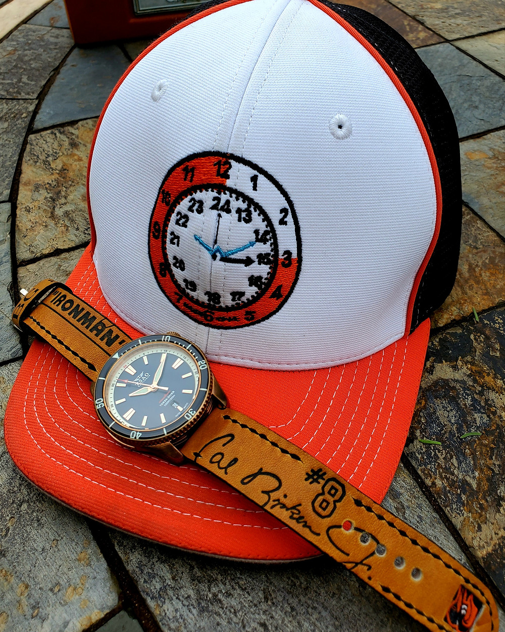 """WOTD wrist-shot of the TSAO Baltimore, Torsk Diver - Bronze, Limited Edition with Wrist-Game """"Brooks"""" Baseball Cap."""
