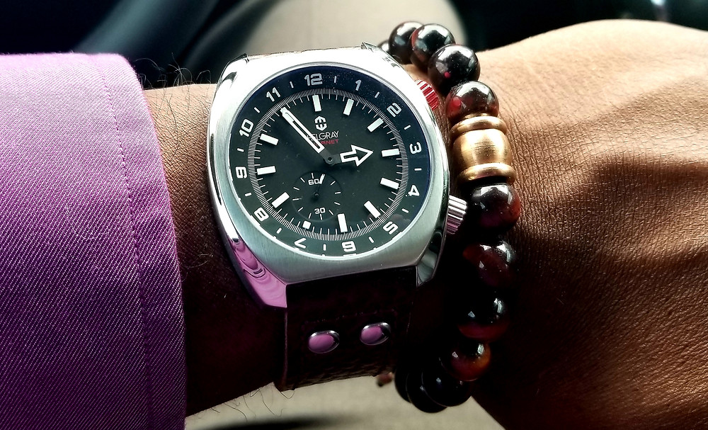 WOTD wrist-shot showing the Helgray, Hornet Fighter on the wrist, accompanied by a tiger's-eye beaded bracelet.