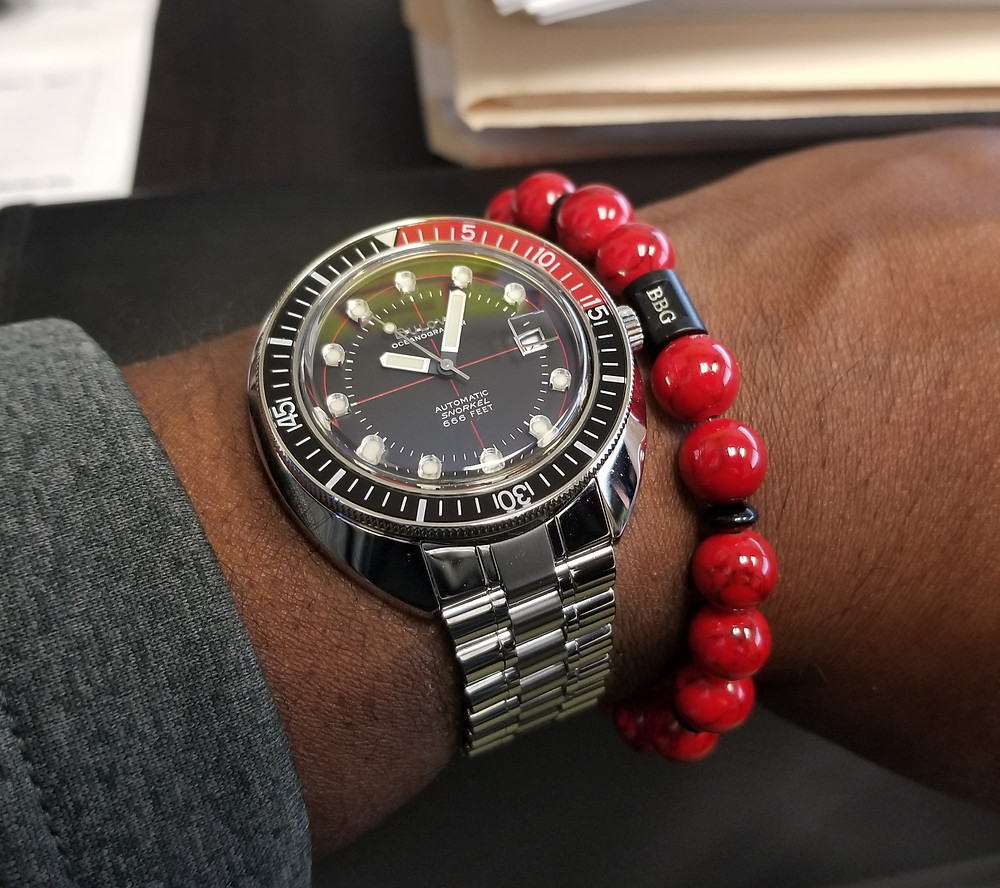 WOTD wrist shot of the Bulova, Oceanographer, Devil Diver 666, paired with a custom Beads By Gonzo beaded bracelet.