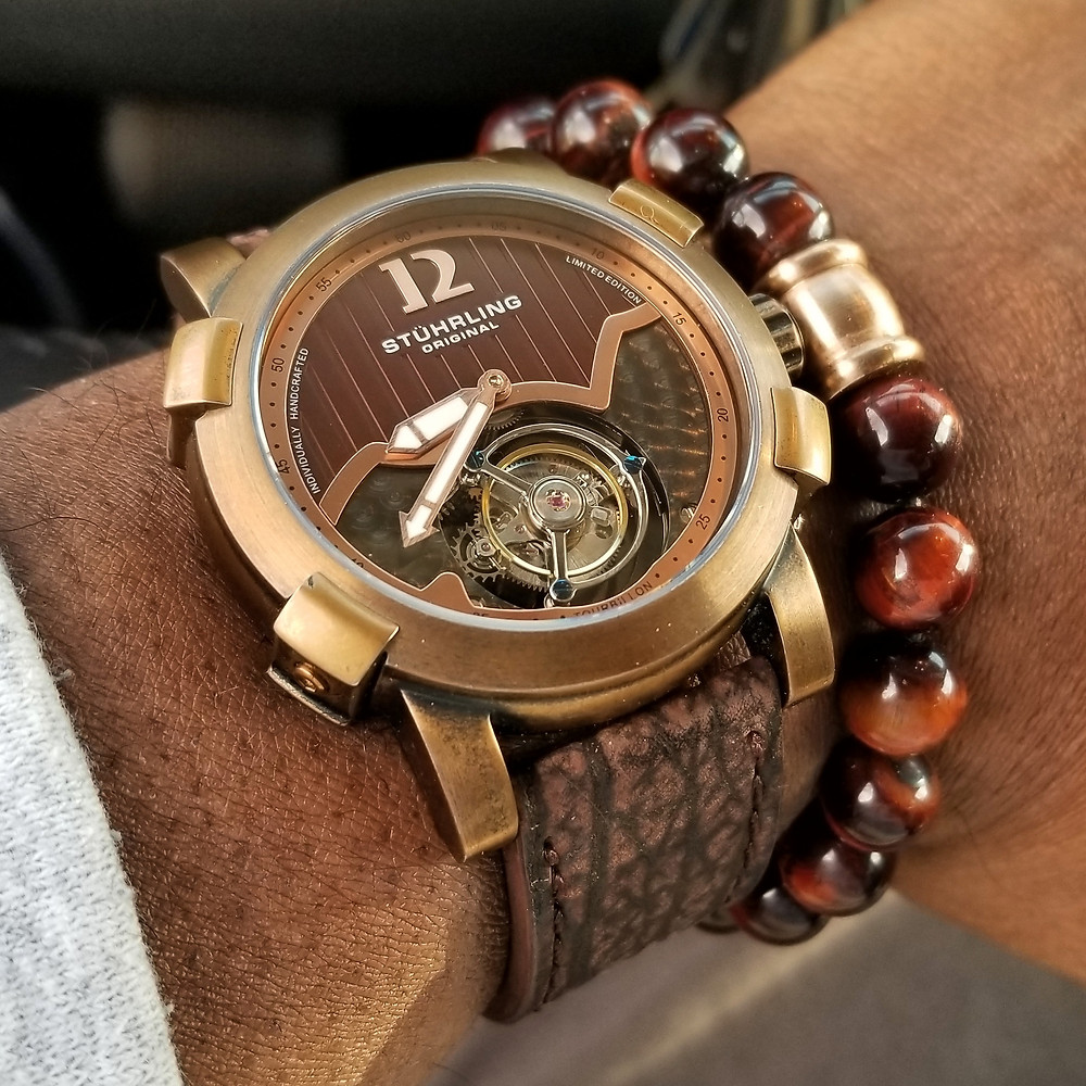 WOTD wrist-shot of the Stuhrling Original, Devilray Tourbillon, Limited Edition.  Paired with a tiger's-eye, beaded bracelet.