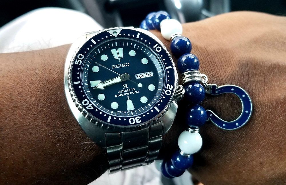 WOTD wrist shot of the Seiko, Prospex, Automatic Diver, A/K/A Turtle, accompanied by custom Beads By Gonzo beaded bracelet.