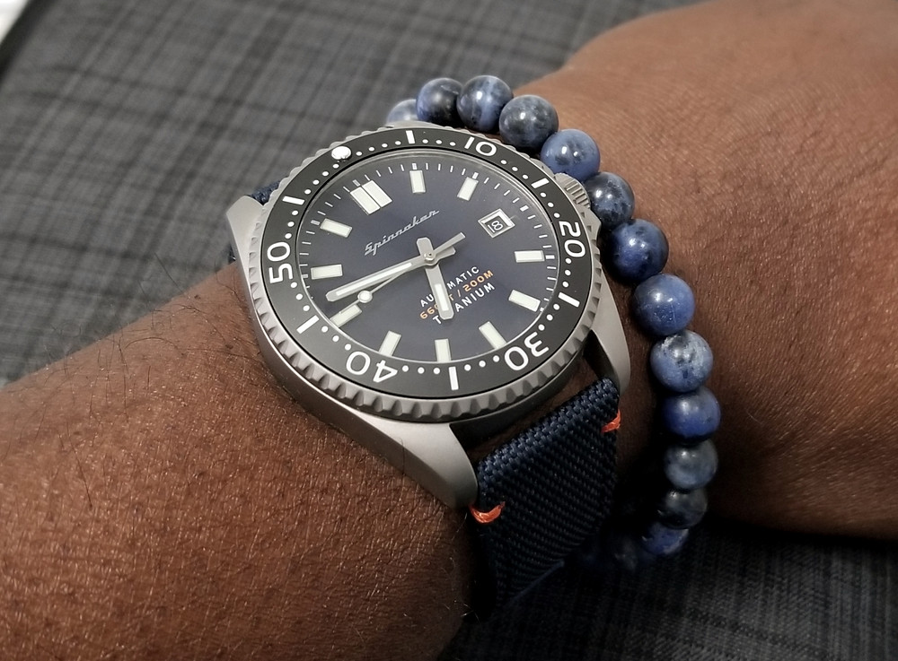 WOTD wrist-shot of the Spinnaker, Tesei Titanium.  Paired with a minimalist, Sodalite stone beaded bracelet, designed by Aurum Brothers.