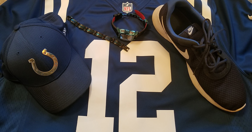 Indianapolis Colts team hat, Nike jersey, Nike shoes, Invicta Reserve, Sapphire Ghost timepiece, and INOX Flat Bracelet.