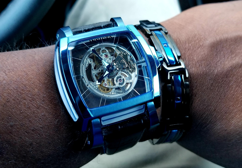 WOTD wrist-shot of the Invicta Reserve, Sapphire Ghost, in electric blue plating, accompanied by an INOX flat bracelet in electric blue plating.