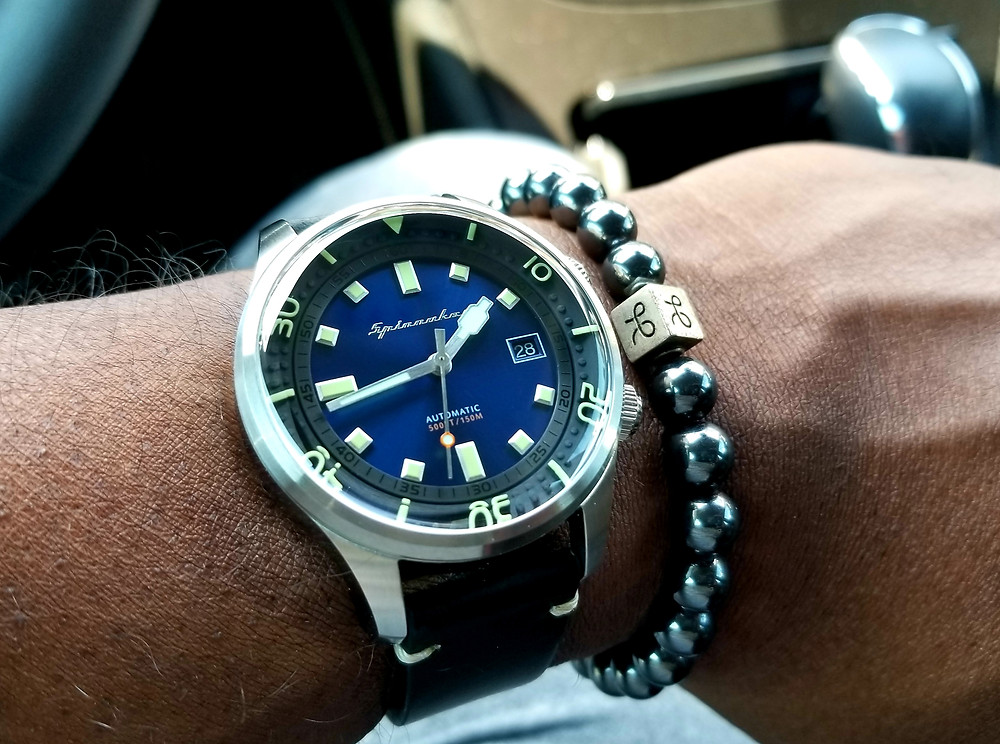 WOTD Wrist-Shot showing the Spinnaker, Bradner, SP-5057, Vintage Diver, paired with an Aurum Brothers, Minimalist, Hematite beaded bracelet.