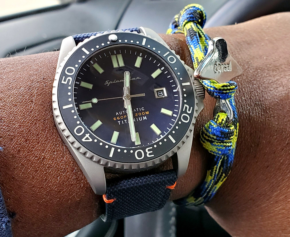 WOTD wrist-shot of the Spinnaker, Tesei - Titanium, E.  Paired with an Eagle Ray, rope bracelet, in color selection Peacock, designed by Dorsal Bracelet Co.