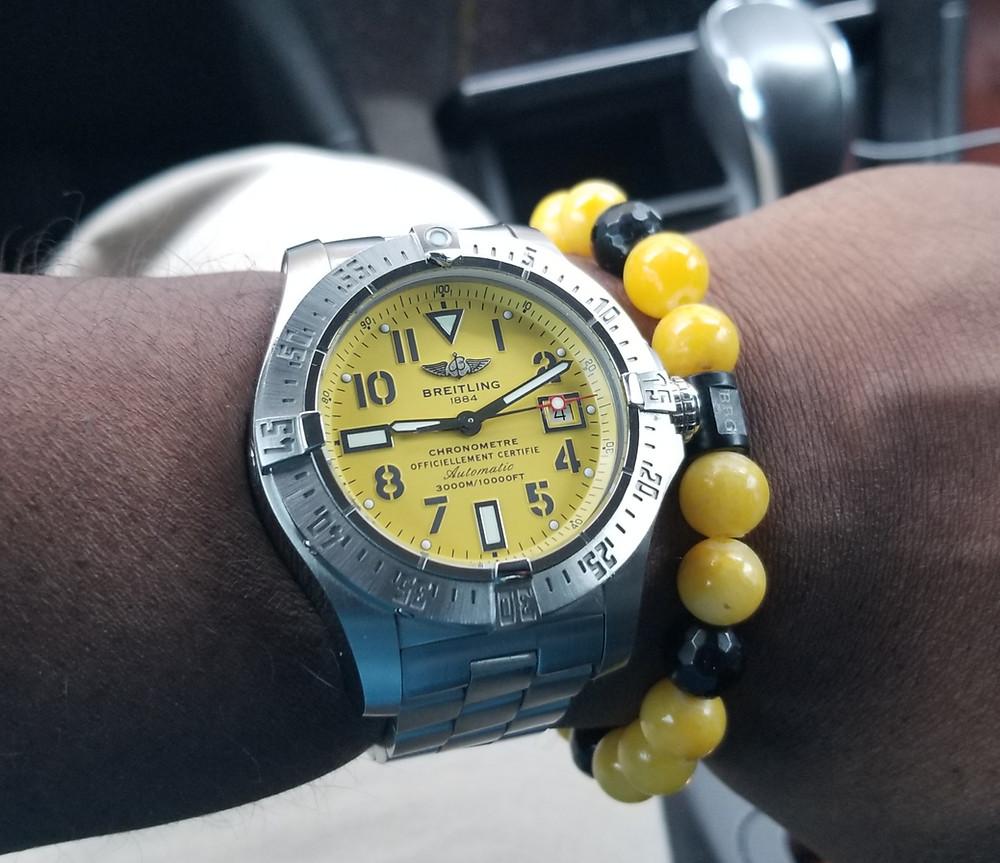WOTD wrist shot of the Breitling, Avenger, Seawolf, accompanied by custom Beads By Gonzo beaded bracelet.