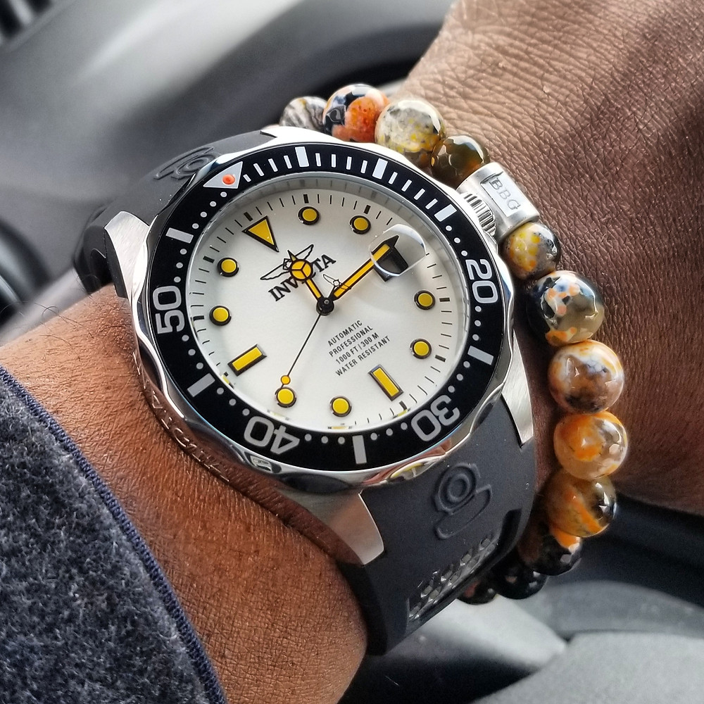 "WOTD wrist-shot, of the Invicta ""Creamsicle"" Grand Diver, Automatic.  Paired with a custom, beaded bracelet, crafted by Beads By Gonzo."