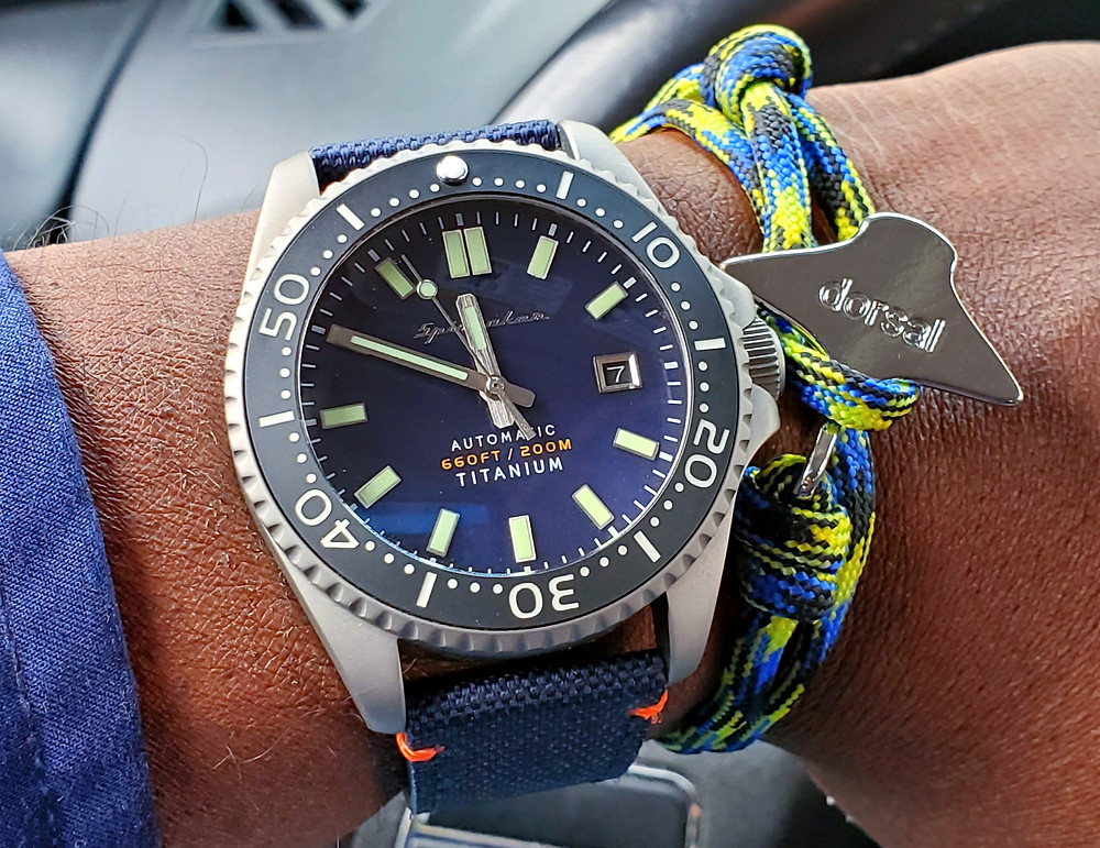Wrist-Shot of the Spinnaker, Tesei - Titanium.  Paired with an Eagle Ray, rope bracelet, designed by Dorsal Bracelet Company.