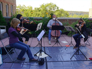 Members of MMFO playing on a NYC rooftop