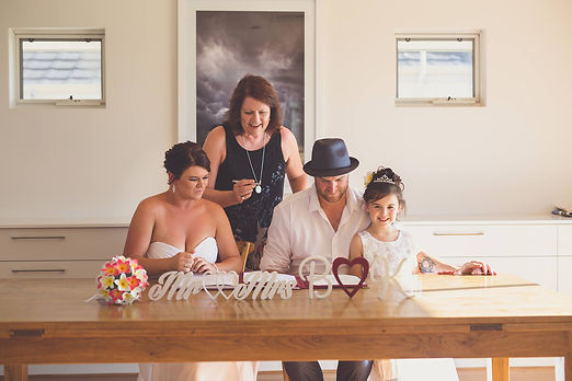 Couple with daughter, just doing the legals - signing the register a home